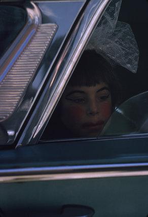 Girl in car, parade, USA. c. 1964