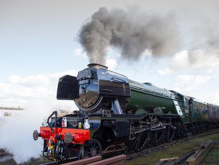 Flying Scotsman locomotive leaving the National Railway Museum, 2016.