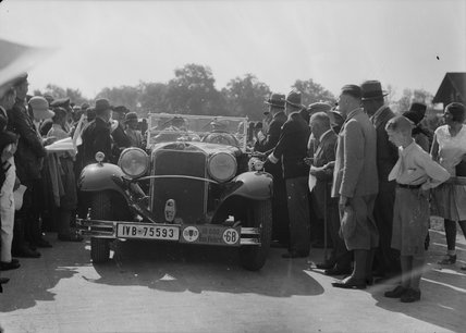 Crowd surrounds Mercedes Benz car, no. 68. c.1930.