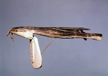 Wooden log-ship, in the form of a fish, probably early 19th century.