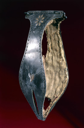 Iron chastity belt lined with silk, posibly 16th century.