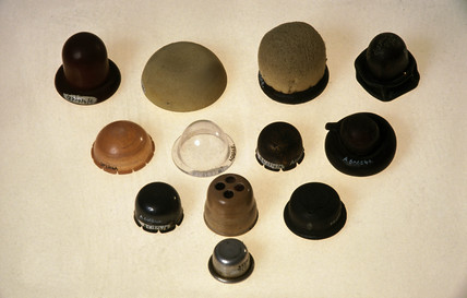 Range of contraceptive cervical caps, 20th century.