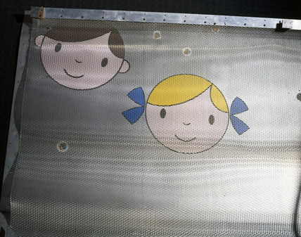 Cartoon faces on the Faraday cage of an MRI scanner, early 1970s.