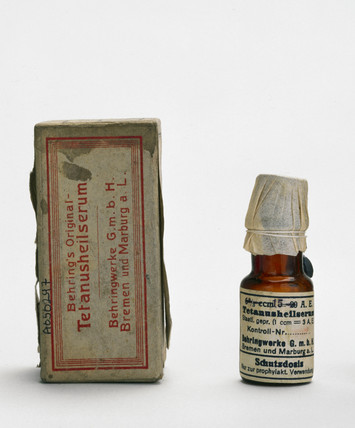 Bottle of Behring's original tetanus serum and packet, c 1915.