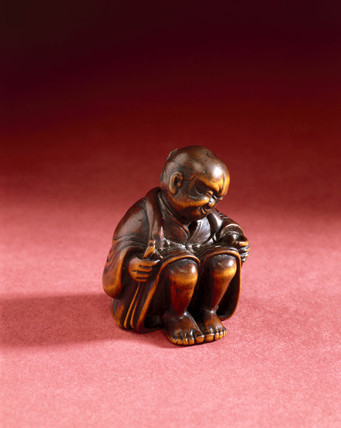 Netsuke showing a man applying moxa, Japanese, late 18th century.