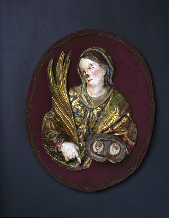 Wooden plaque of St Lucy of Syracuse, Spanish, 17th century.
