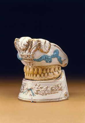 Upper and lower denture contained in porcelain holder, c 1780-1820.