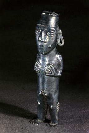 Silver male deity statue, Peruvian.