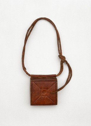 Tooled leather amuletic case, Sudanese, c 1890-1920.