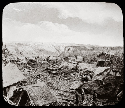 Villagers on the site of houses devastated by earthquake, Japan, 1876.