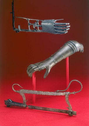 Amputation saw and two artificial arms, 16th century.