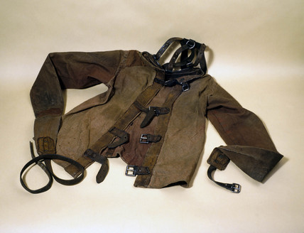 Canvas and leather strait jacket, c 1930.