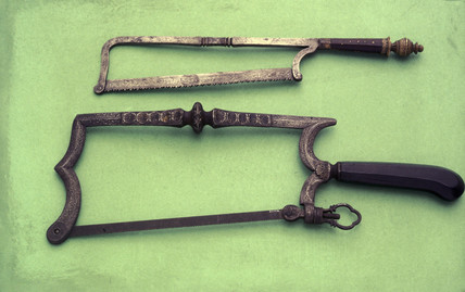 Two bow framed amputation saws, Spanish, c 1650.