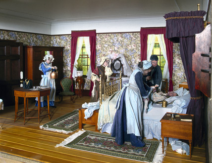 Diorama in the Science Museum illustrating childbirth in the 1860s.