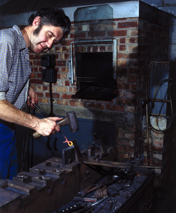 Forging surgical instruments at Arnold & Sons, Essex, 1981.