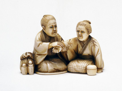 Netsuke showing a doctor and patient, Japanese, late 19th century.