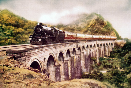 Steam locomotive crosing a viaduct, India, c 1930s.