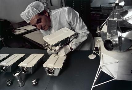 Technician asembling Apollo 9 television cameras, 1969.