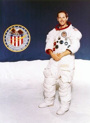 Astronaut Charles Duke with Apollo 16 mision badge, 1971.