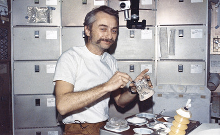 Astronaut Owen Garriott eating in space on board Skylab, 1973.