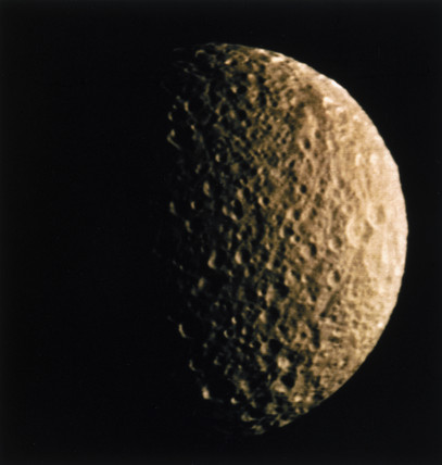 Mimas, one of the moons of Saturn, photographed by Voyager 1, 1980.