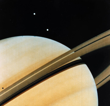Saturn and two of its moons, Tethys and Dione, 1980.