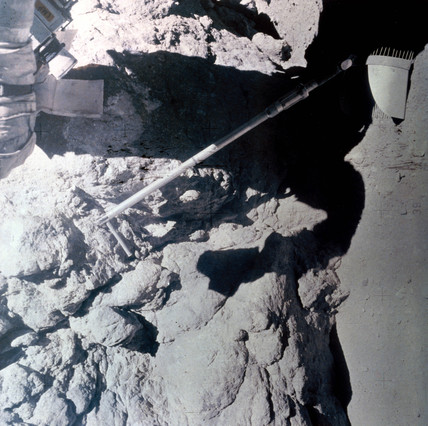 Apollo 17 sample scoop, photographed against lunar rock, 1972.