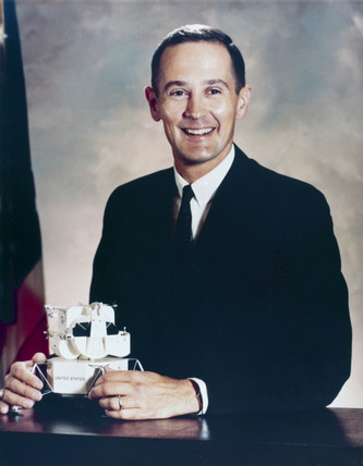 Astronaut Charles Duke in formal suit, 1966.