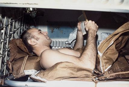 Skylab astronaut Alan Bean sleeping, 1973.