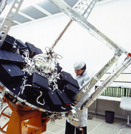 Geos satellite with technician, 1960s.