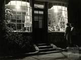 All lit up. Philippa Savery's Antiques Shop in Abbey Churchyard 1956