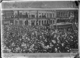 Crowded city scene with tram possibly Wellington, HMS New Zealand, c.1915