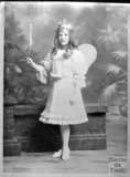 Copy of a studio portrait of a girl dressed as a fairy c.1900s