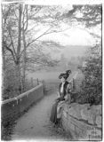 The photographer's wife Violet and their dog, on the bridge crossing the Mill Brook, Monkton Combe, c.1905