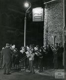 A Christmas Brass Band outside the Kings Head, 1 - 3 Trinity Street, Frome, Somerset, c.1970