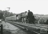 Unidentified Standard Class 4 2-6-0 tender locomotive crossing the Midford Viaduct on the Somerset and Dorset Joint Line, c.1960