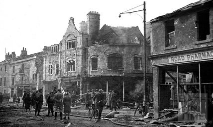 Burnt out shops on the Bear Flat April 1942
