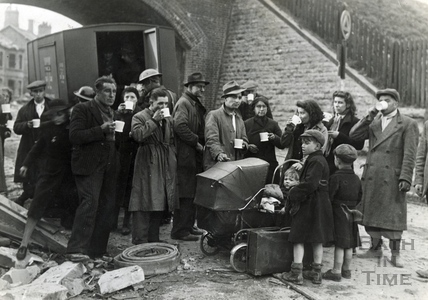 A YMCA mobile canteen provides refreshment after the Bath Blitz, April 1942