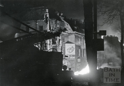 Fires still burn as emergency services stand by a bomb site in Upper Bristol Road, Bath, April 1942