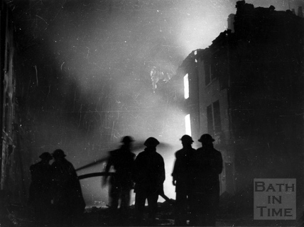 Firemen at work in James Street West, Bath, April 1942