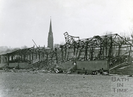 The tangled wreckage of the Bath Rugby West stand at the Recreation Ground, Bath, April 1942