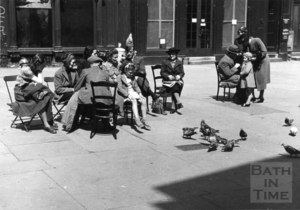 People watching the pigeons in Abbey Churchyard c.1942