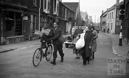 People made homeless by the bombing, carry what possessions they could salvage to shelter, Bath, April 1942