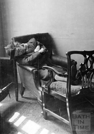 A lady displaced by the Bath Blitz snoozing in a chair, April 1942