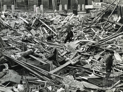 Searching for belongings in the bombed debris of Dolemeads, Bath, 1941