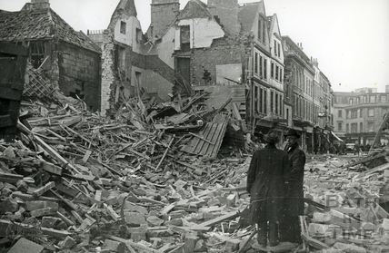 Inspectors stand beside the devastation in Kingsmead Street, Bath, April 1942