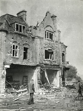 Walking past the devastation in Bear Flat, Bath, April 1942