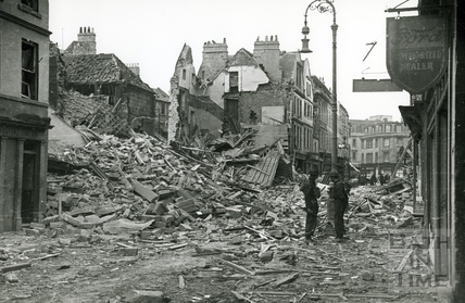 Wardens stand beside the devastation in Kingsmead Street, Bath, April 1942