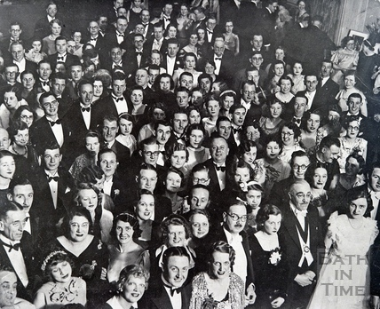 An unknown gathering look up to the camera. Date unknown.