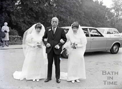 A proud father and most probably his twin daughters at their joint wedding. Date unknown.